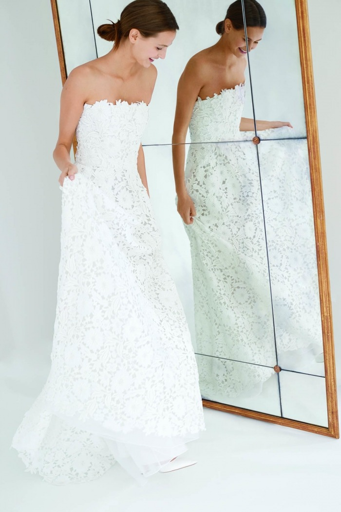 4874b54b8d4 A high neck guipure lace capelet provides personalization when paired with  a strapless column gown. Signature elements of surprise and femininity are  ...
