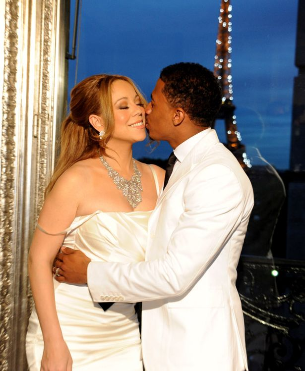 Mariah Carey, left, and her husband Nick Cannon pose in Paris, for the renewal of their wedding vows, Friday, April 27, 2012-812134